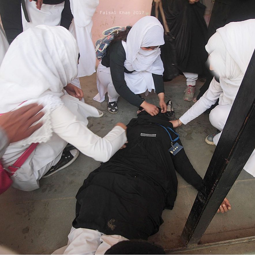 A student lies unconscious after inhaling tear smoke fired by Indian police in the college premises in Srinagar the summer capital of Indian controlled Kashmir on April 17, 2017.