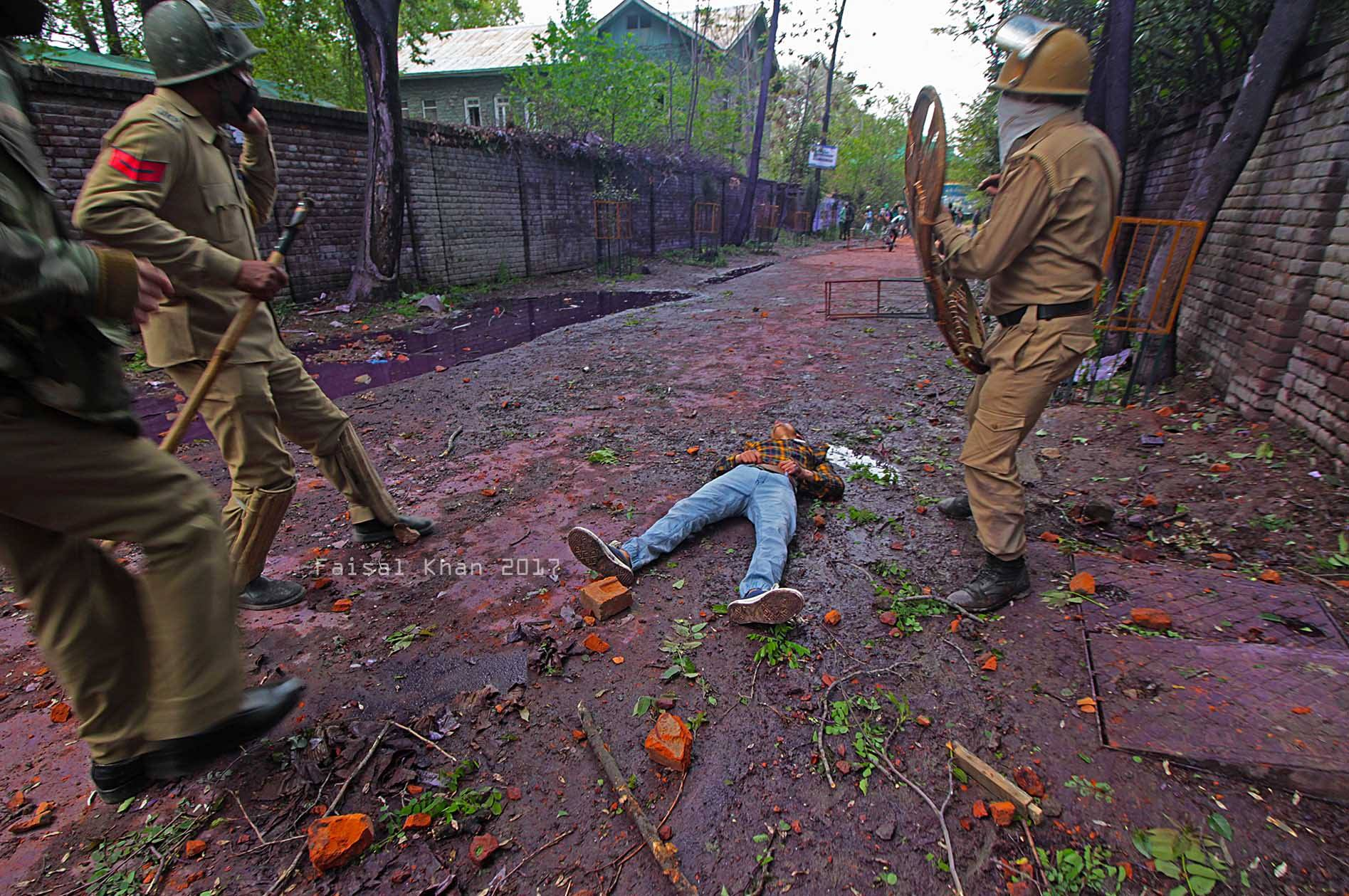 An injured boy lies unconscious during clashes between students and Indian police in Srinagar Kashmir on April 24, 2017.