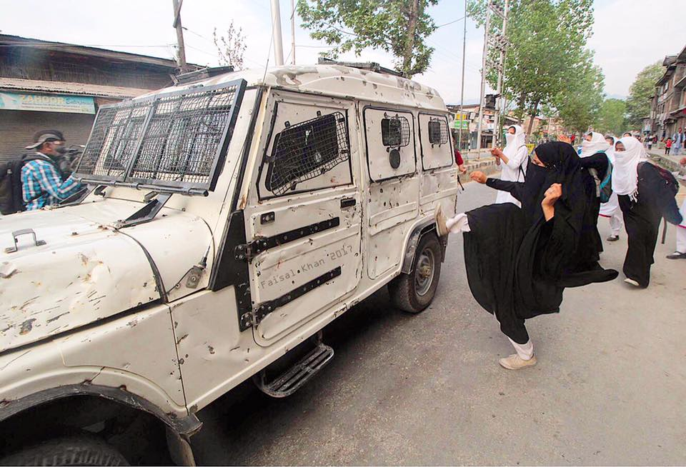 A student kicks a police vehicle during a protest in Srinagar the summer capital of Indian controlled Kashmir on April 20, 2017.