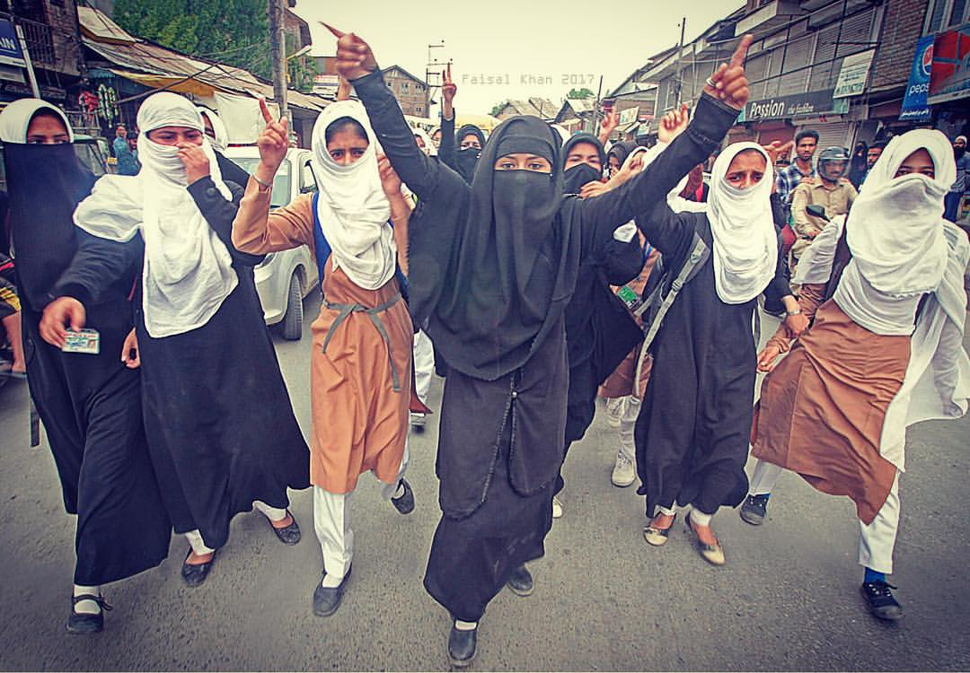 Students march as they shout slogans during a protest in Srinagar the summer capital of Indian controlled Kashmir on April 19, 2017.